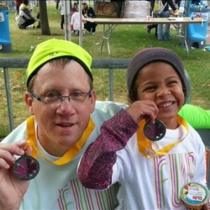 Doug and his niece conquering the toddler trot four years in a row!